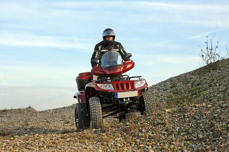 With the Quad through the terrain photo