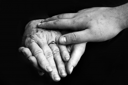 Hands of several generations - protect, help, lead