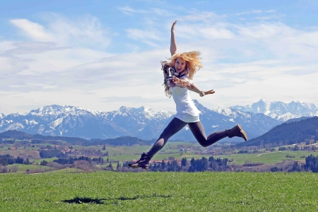 live happy: Jumping for joy in the air Stock Photo