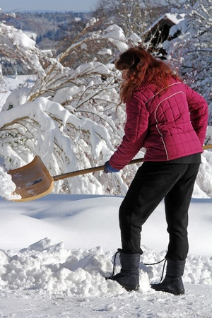 Shoveling snow after heavy snowfall in Bavaria