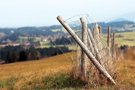 thaler: The broken fence in the meadow Stock Photo