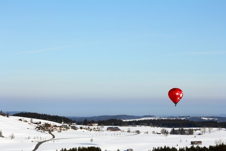 Hot air balloon rides over the winter Bavaria photo
