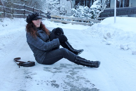 snow clearing: Injury on slippery winter roads Stock Photo