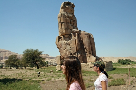 Two Tourists from the great Colossi of Memnon at Thebes in Egypt Фото со стока