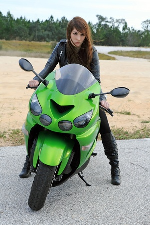 A young woman on the motorcycle photo