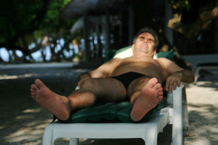 lie forward: A man relaxing on holiday