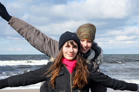 Two girlfriends have fun at the sea Stock Photo - 19202347