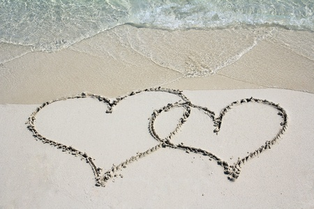love proof: Proof of love - Two hearts in the sand beach Stock Photo
