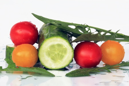 Delicious, fresh, healthy tomatoes and cucumbers photo