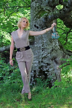 pantsuit: a young woman in modern pant suit with purse