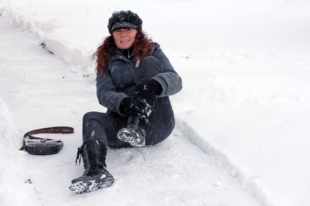 snow break: girl holding her leg Stock Photo