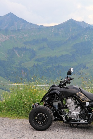 atv with mountain background photo