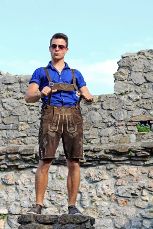 a young man in Bavarian lederhosen photo