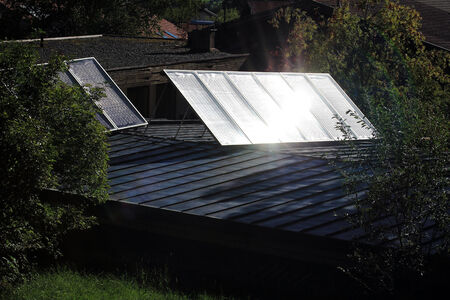 generates: The sun shines on solar panels and generates energy Stock Photo