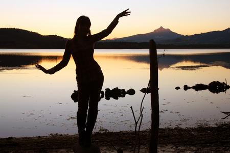 Relaxation exercises on evening lake