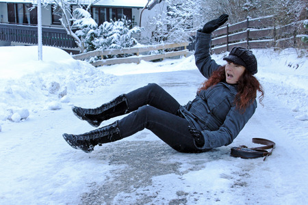 on the ground: Risk of accident by slipping on snow roads and footpaths Stock Photo