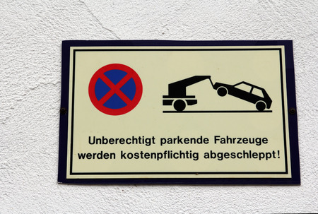 unauthorized: Shield - Unauthorized vehicles will be towed Stock Photo