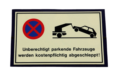 towed: Shield - Unauthorized vehicles will be towed Stock Photo