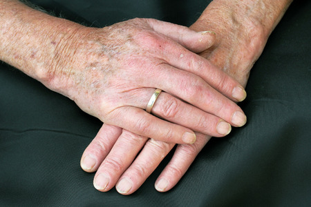 The hands of an old couple