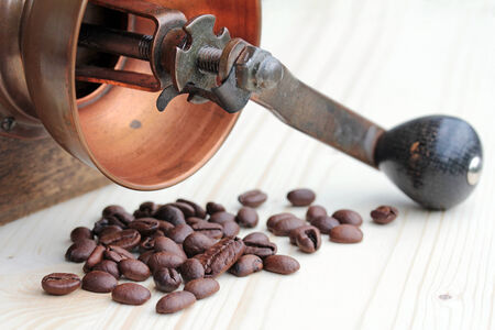 Coffee beans and old coffee mill Stock Photo - 30810663