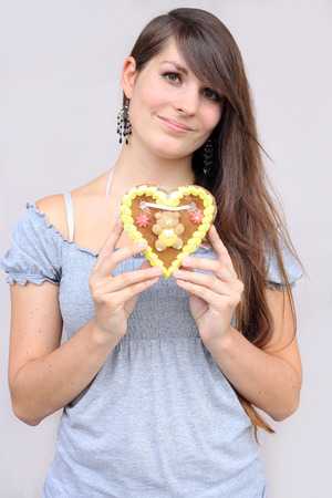 The girl with gingerbread heart photo