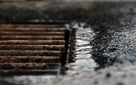 gratings: an old rain runoff on the road