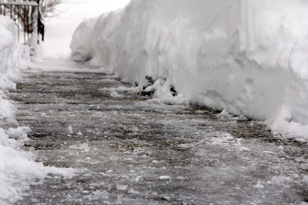 broaching: Dangerous black ice on a footpath