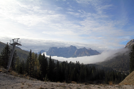 early fog: early fog in the Dolomites (italtien). Clouds of mist in the mountains of the Dolomites