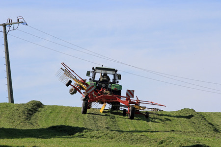 agriculture machinery: Mowing in the summer on the field. The farm work during the summer Stock Photo