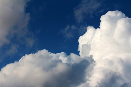 float cotton cloud: White clouds in the blue sky. Loose clouds in the sky