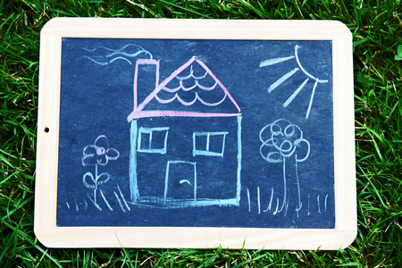 Ownership A house on a blackboard. A drawing of a house
