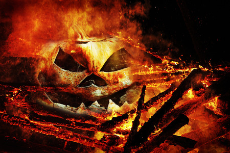 pumpkin head: A creepy pumpkin head in the fire. A pumpkin head in the flames Stock Photo
