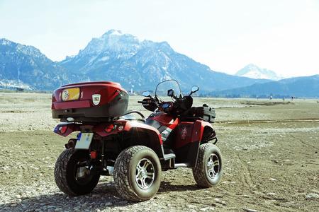 quad: An ATV of the Allgu mountains. With the quad through the dry lake