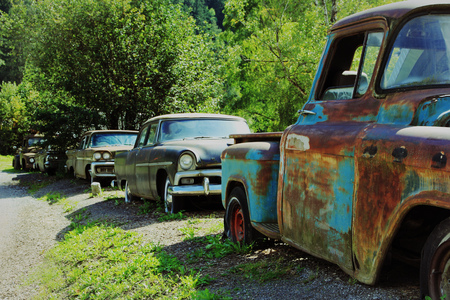 Old rusty cars. Rusted American vintage