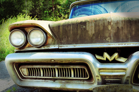 old mercury: The old rusty car. An old Mercury from the USA