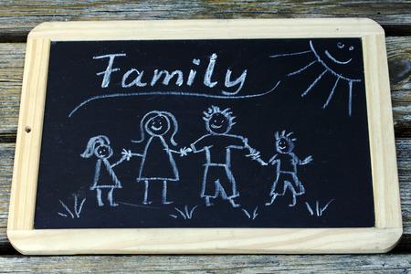 A happy family, drawn on a blackboard Stock Photo