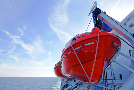Red Lifeboat on a ship. Lifeboats on a ferry