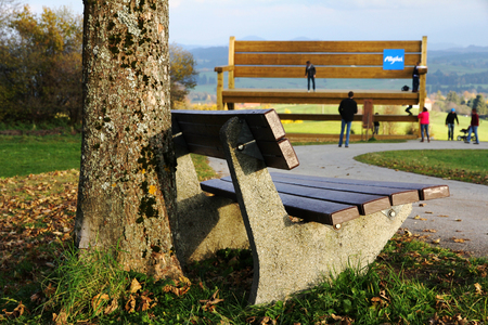 exceptionally: The small and the large bench in the Allgu. A resting place in front of the large wooden bench - a tourist attraction in the Allgu Stock Photo