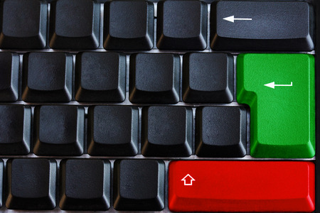 technically: Black computer keyboard with green and red button and arrows Stock Photo