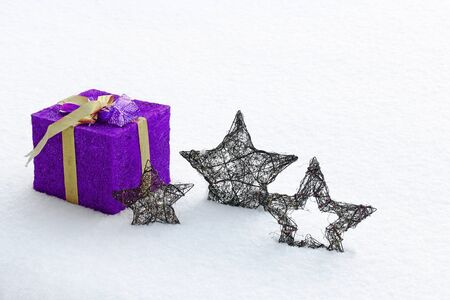 the snowflake: The large purple Christmas and the Christmas star in snow