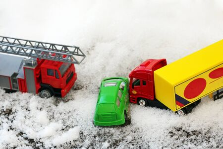 fire car: A trailing with toy cars wintry accident. Accidents with packed snow