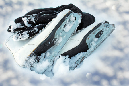 winter sports: Ice skating is a popular winter sports. Skates in Sparkling Snow Stock Photo
