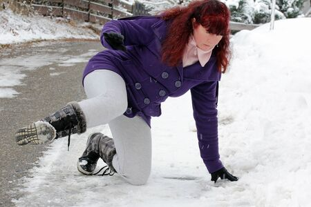 Risk of accidents in winter - A woman slipped on a snow slippery road