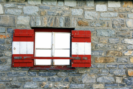 red shutters: A mountain hut in Austria. Austrian window with red and white shutters