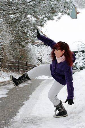 slipped: Risk of accidents in winter - A woman slipped on a snow slippery road