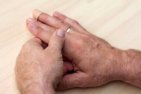 bone cancer: An elderly man has pain in fingers and hands