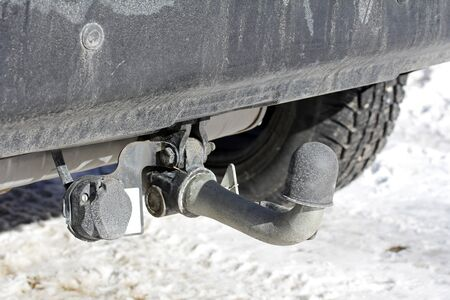 hitch: Trailer hitch on a car with cap in winter Stock Photo