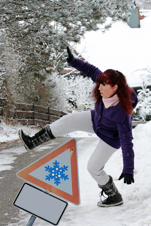 slipped: Accident risk in winter - A woman slips on a slippery road snow