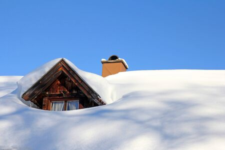 snowed: A snowed roof window of an old wooden house