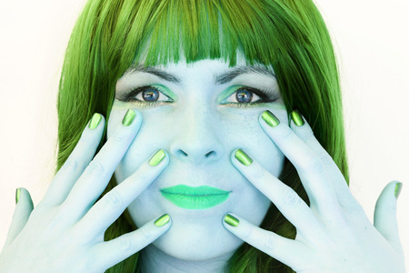 conspicuous: The woman with the green hair and green makeup Stock Photo